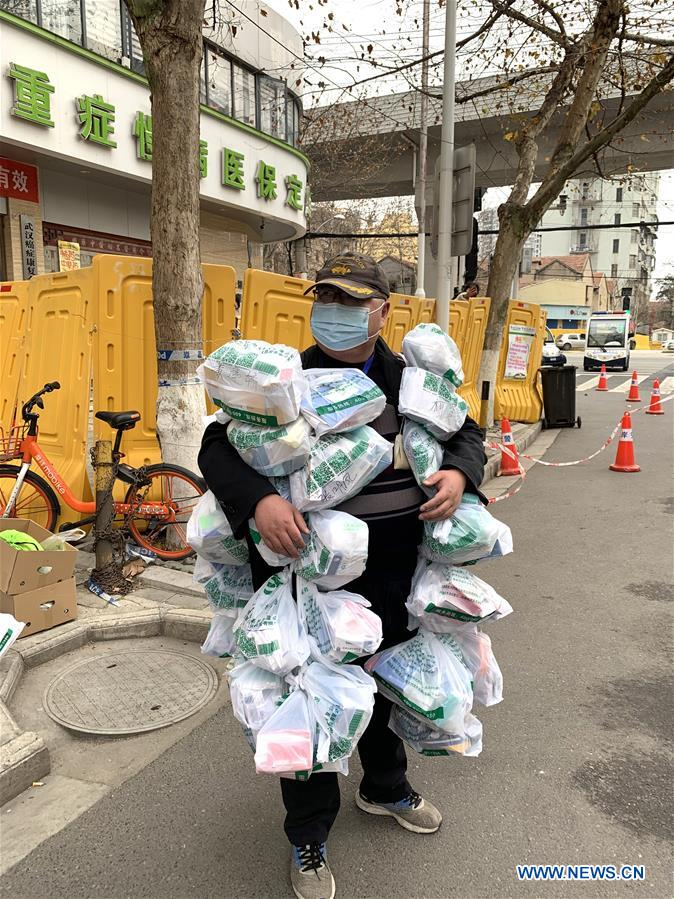 Community worker helps residents to buy medicines in Wuhan amid epidemic