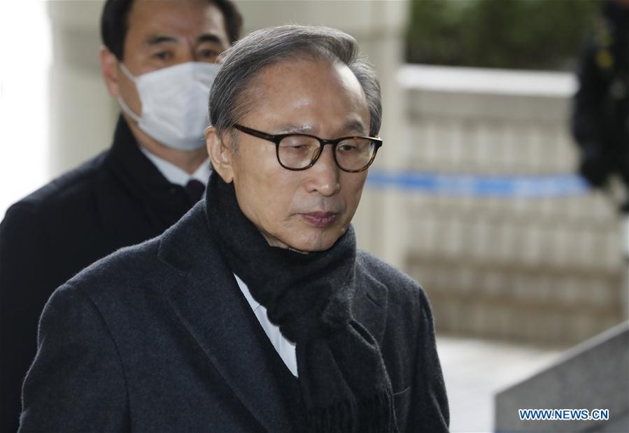 Former South Korean President Lee Myung-bak arrives at Seoul High Court