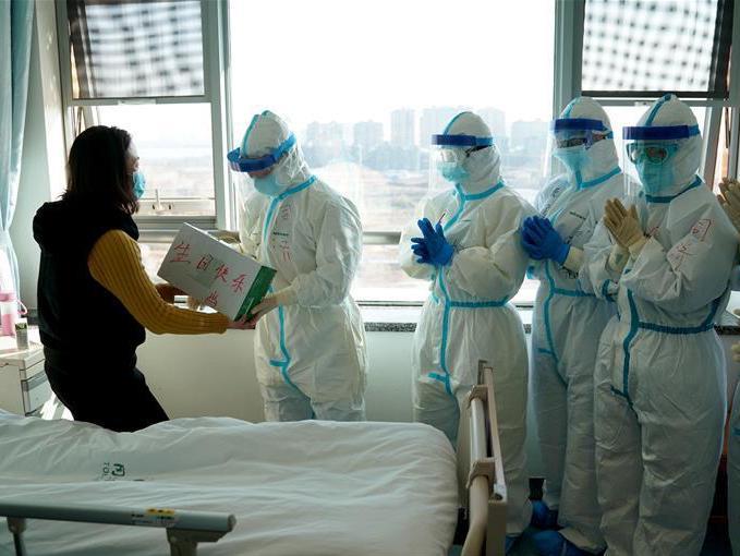 China's island province lowers coronavirus response
