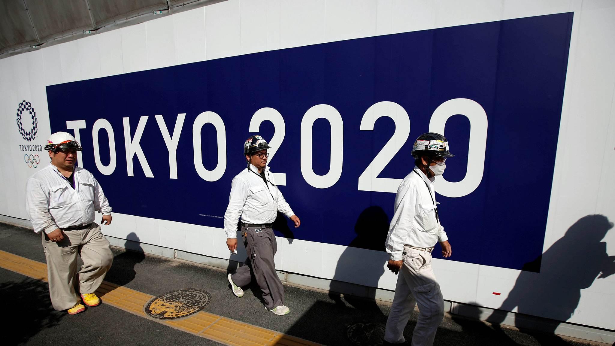 Tokyo Olympics on, organisers say, as virus hits Japan events