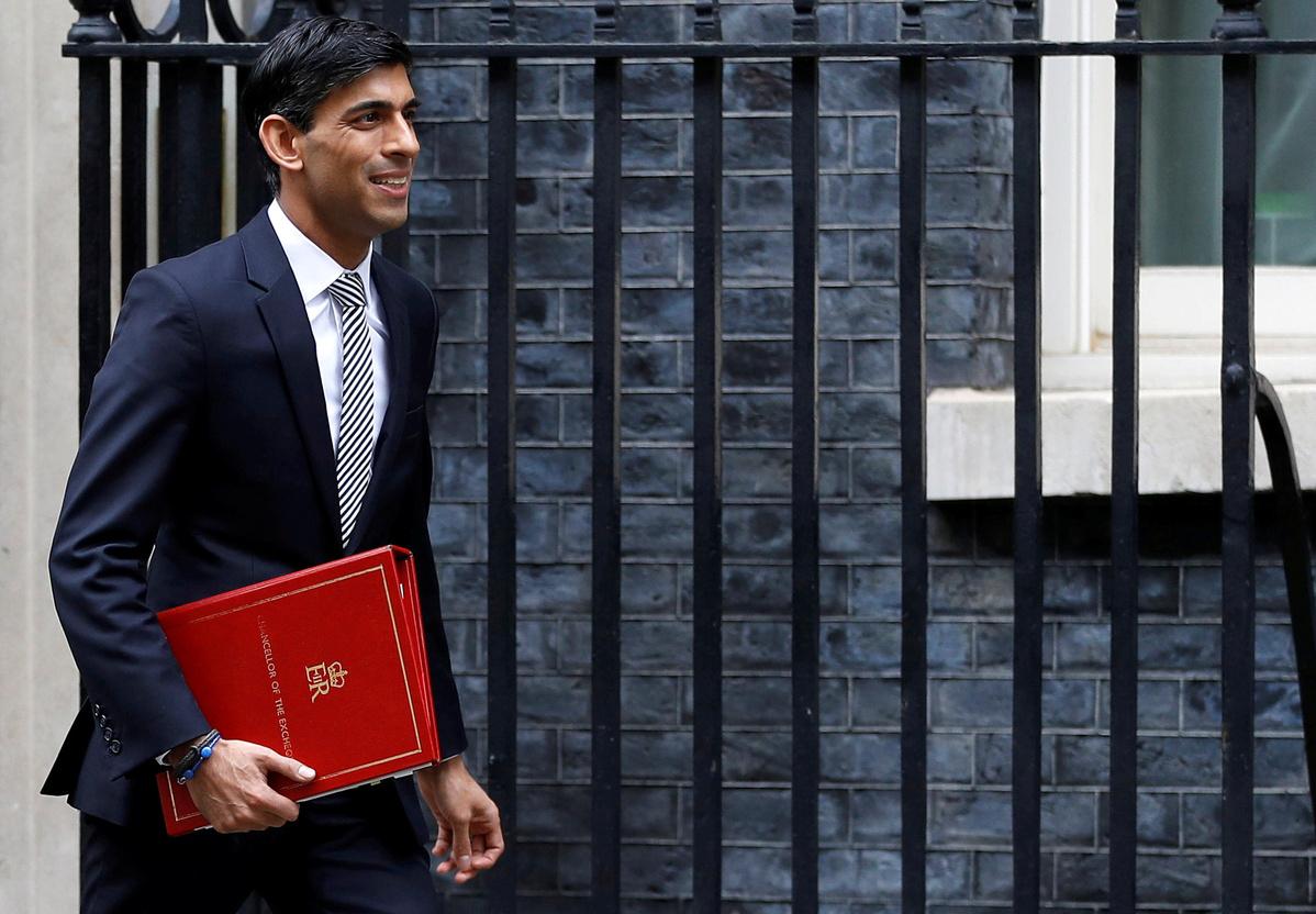 Thousands of UK job losses put shadow on budget