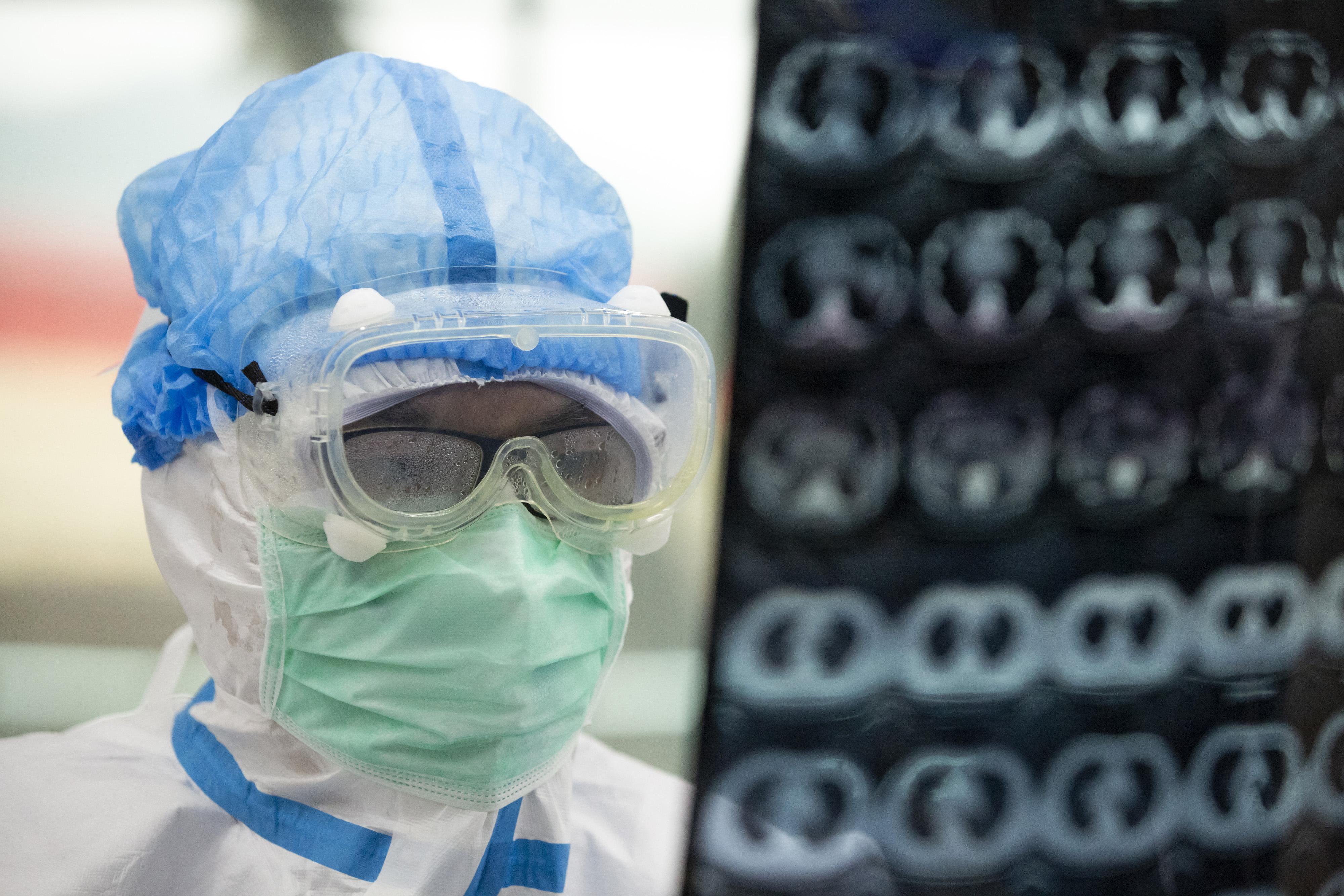 China's Hubei reports 318 new coronavirus cases