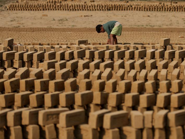 Laborers work at brick kiln in Yangon, Myanmar