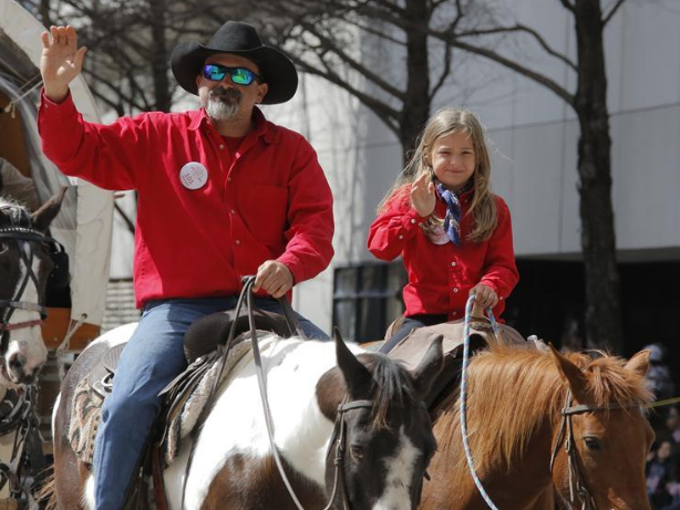 People participate in parade to greet upcoming Houston Livestock Show and Rodeo