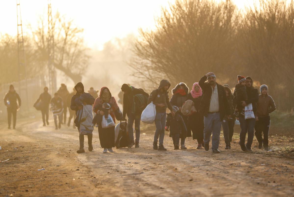 Erdogan threatens EU with migrants surge