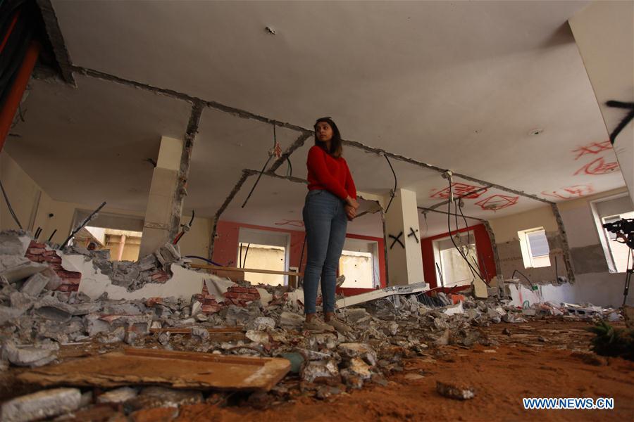 Palestinians inspect house destroyed by Israeli army in Birzeit