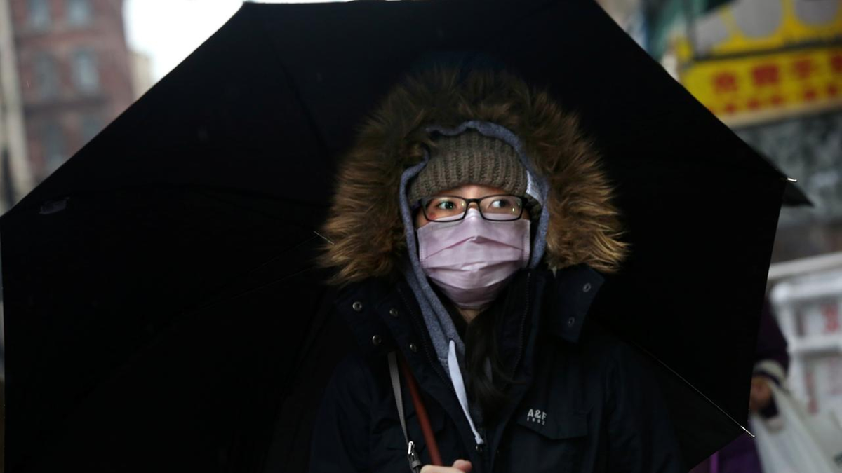 Beijing mulls legislation on mask wearing