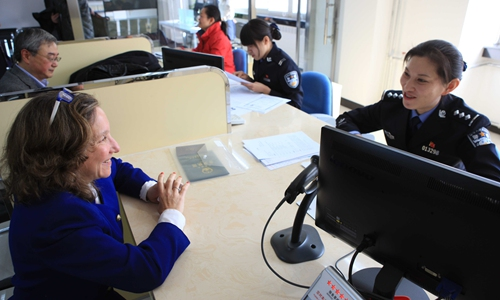 China to exercise prudence before enforcing new 'green card' rules for foreigners