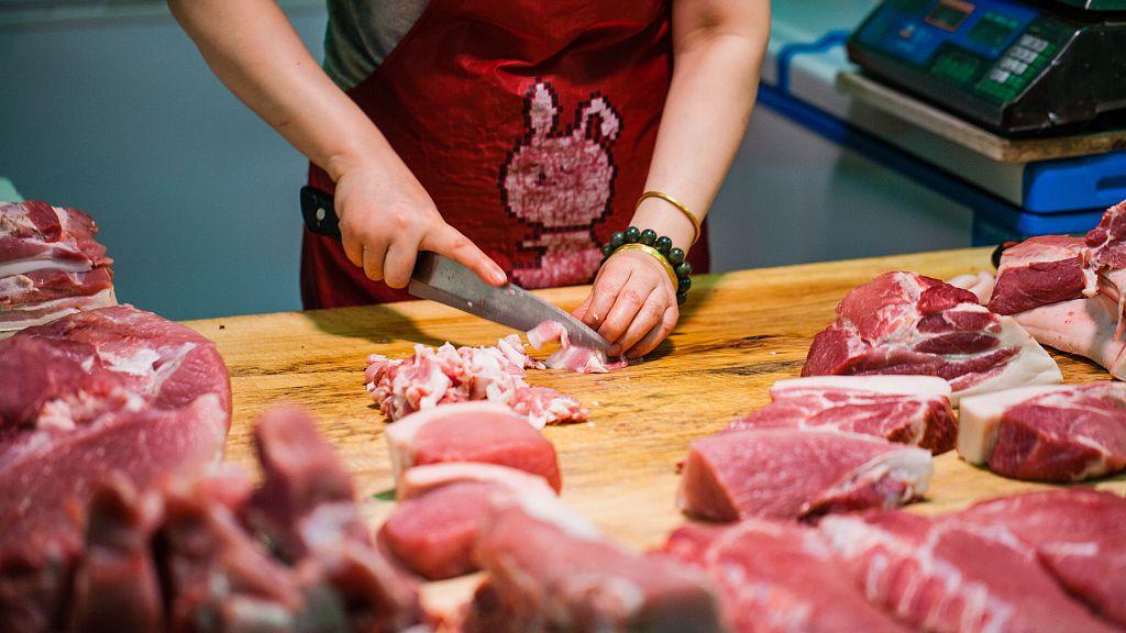China's pork prices dip last week
