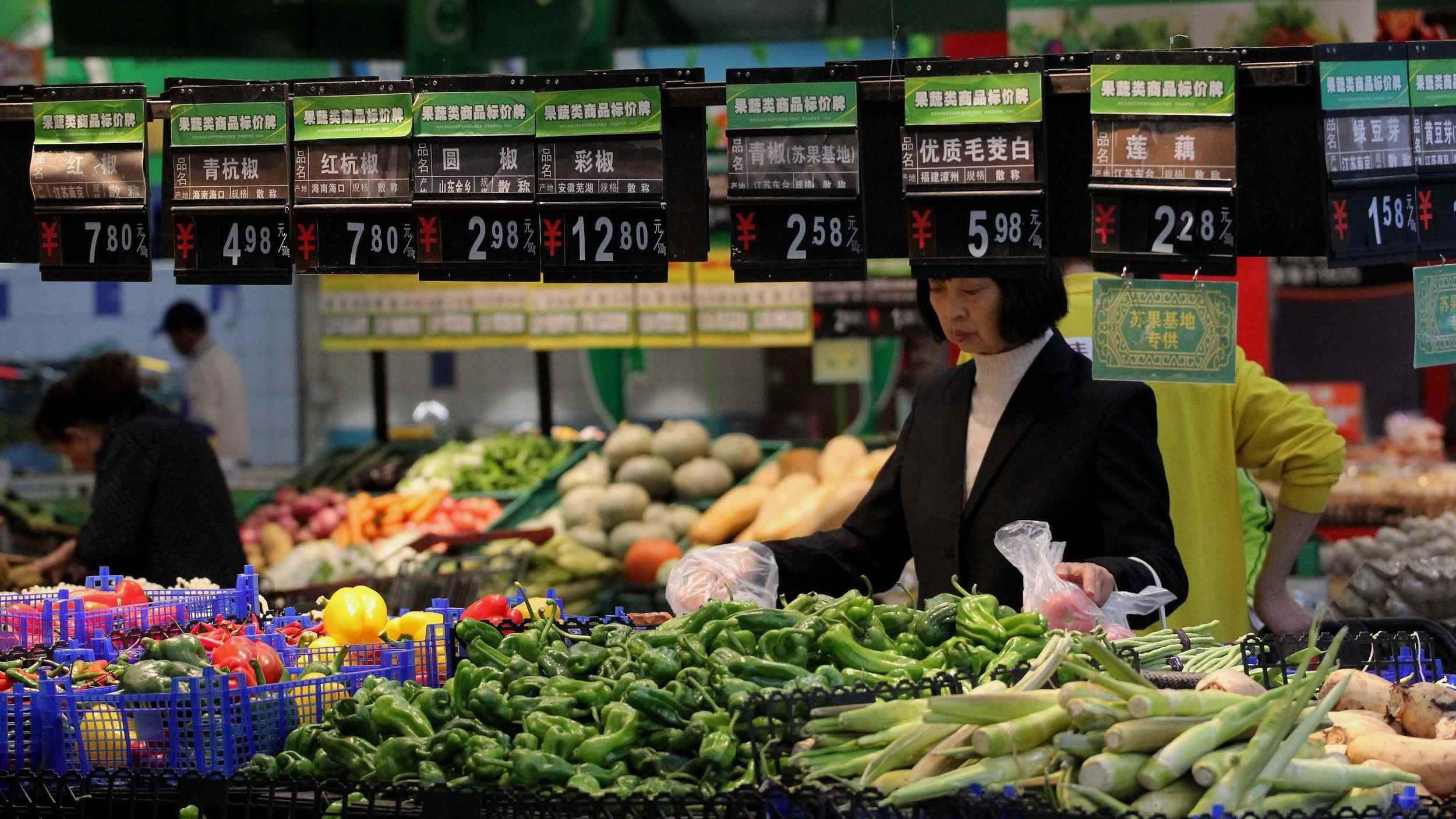Economic Watch: China's consumer inflation eases, factory prices fall
