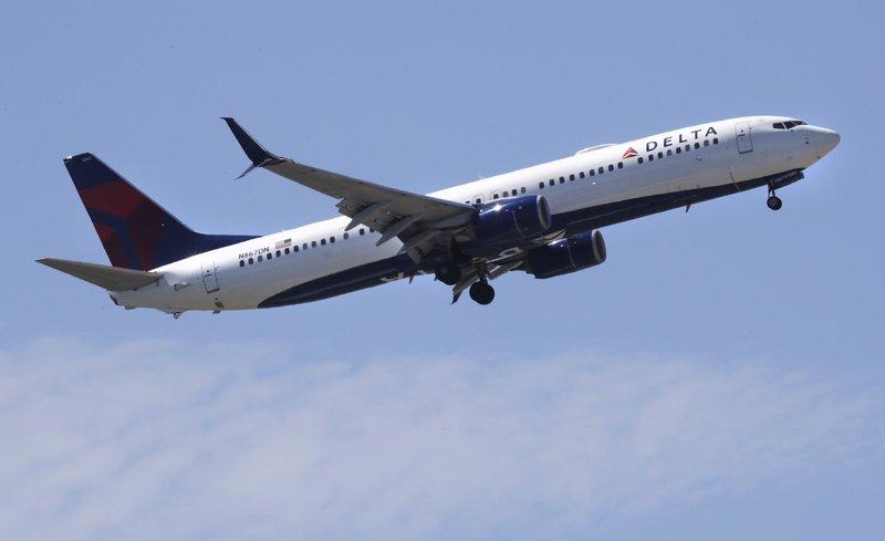 Airlines slash flights, freeze hiring as virus cuts travel