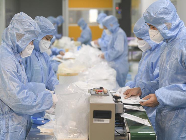 Top regulator forms team to help SOEs push production of fabric needed in masks