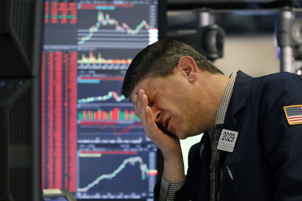 Dow plunges over 1,400 points, ending in bear market