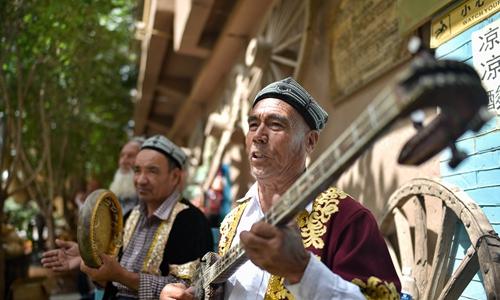 Award winner in US wanted in Xinjiang for fraud