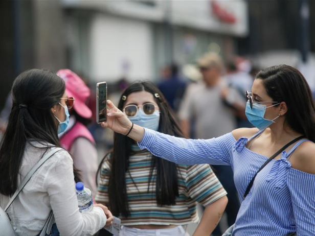 Pedestrians wearing face masks seen in Mexico City