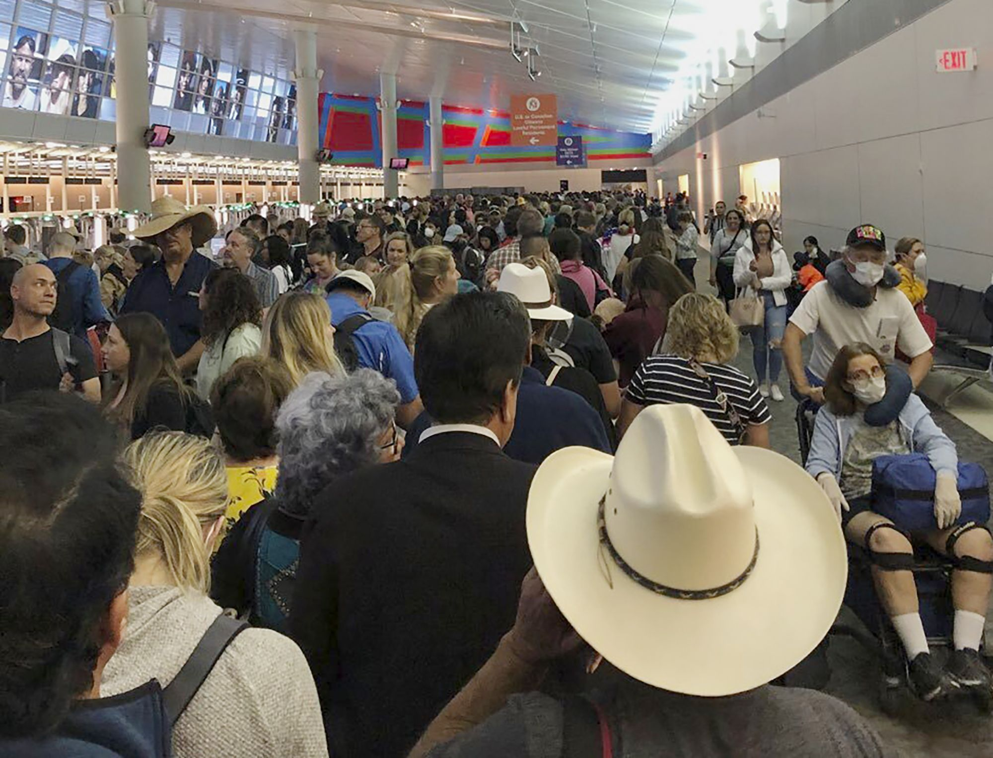 Americans return to long waits for screenings at airports