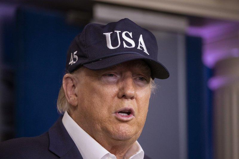 As virus roils markets, Trump again threatens Fed chairman