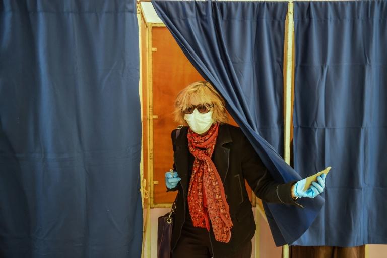 Hand gel at the ballot box as France votes amid virus clampdown