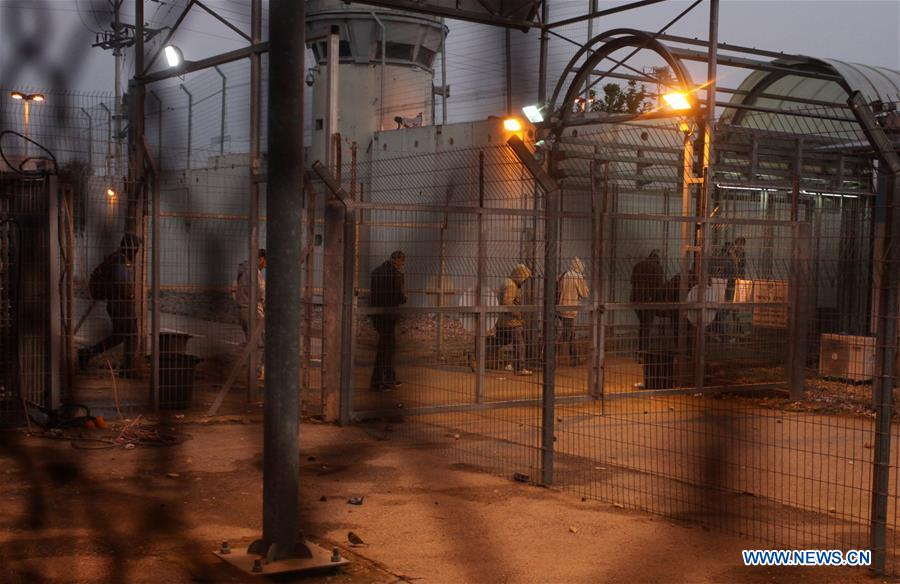 Palestinian workers cross Israeli checkpoint of Eyal to work in Israel