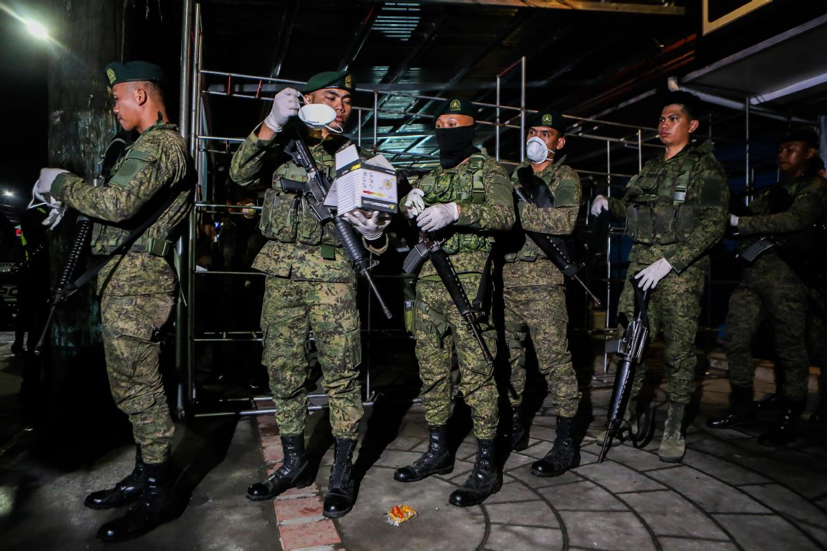 Manila goes into lockdown and Beijing offers to help
