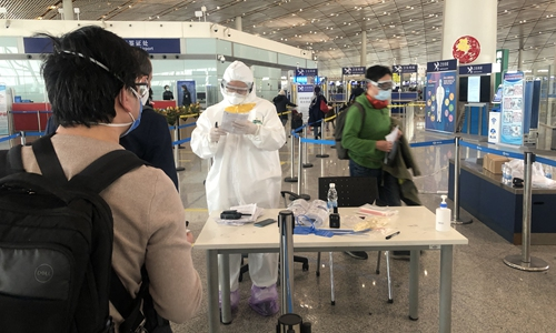All overseas arrivals to Beijing to undergo a 14-day quarantine at designated places starting from Monday