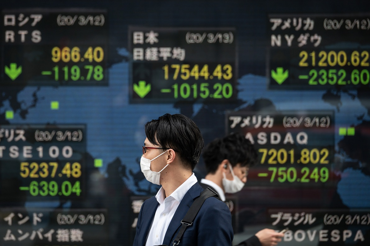 Asian markets sink as early stimulus rally fizzles