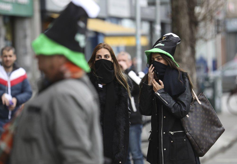 Virus dampens St. Patrick's Day revels around the world
