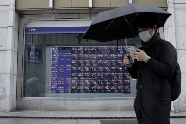Japan's central bank conducts emergency bond buying to tackle rising yields