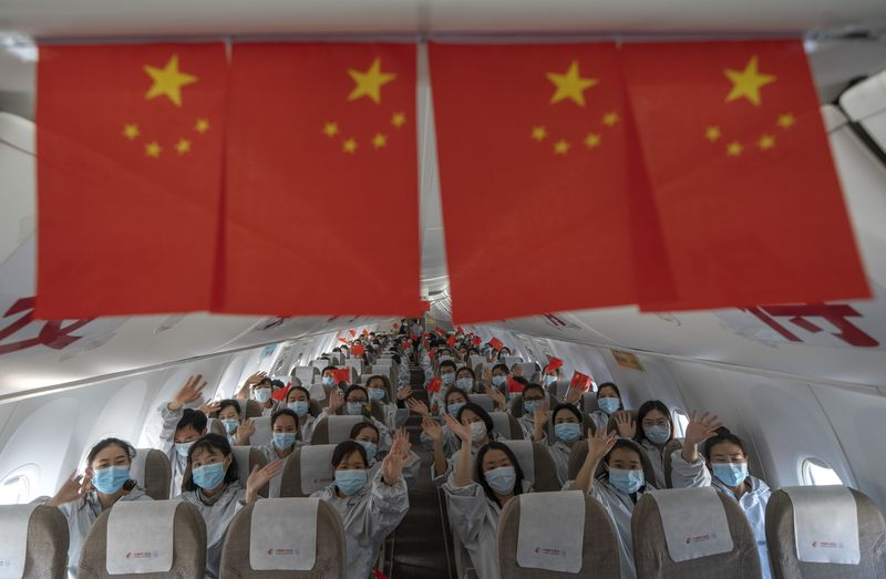 12,000 supporting medics leave Hubei for home: official