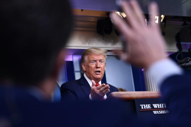 Trump deploys hospital ships in coronavirus 'war'