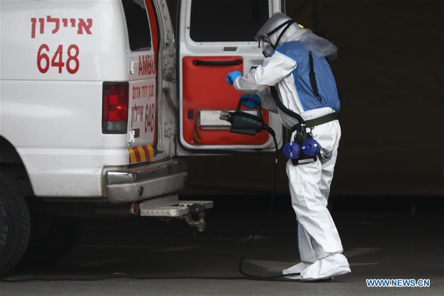 Worker disinfects ambulance to prevent against novel coronavirus in Tel Aviv, Israel