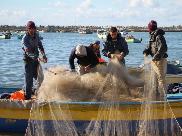 Palestinian fishermen work at seaport in Gaza City