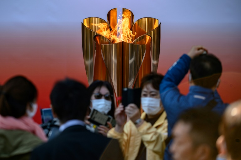 Thousands flock to see Olympic flame in Japan despite virus fears