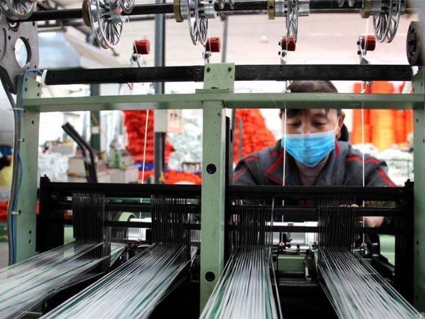 Enterprises resume production under strict prevention measures in China