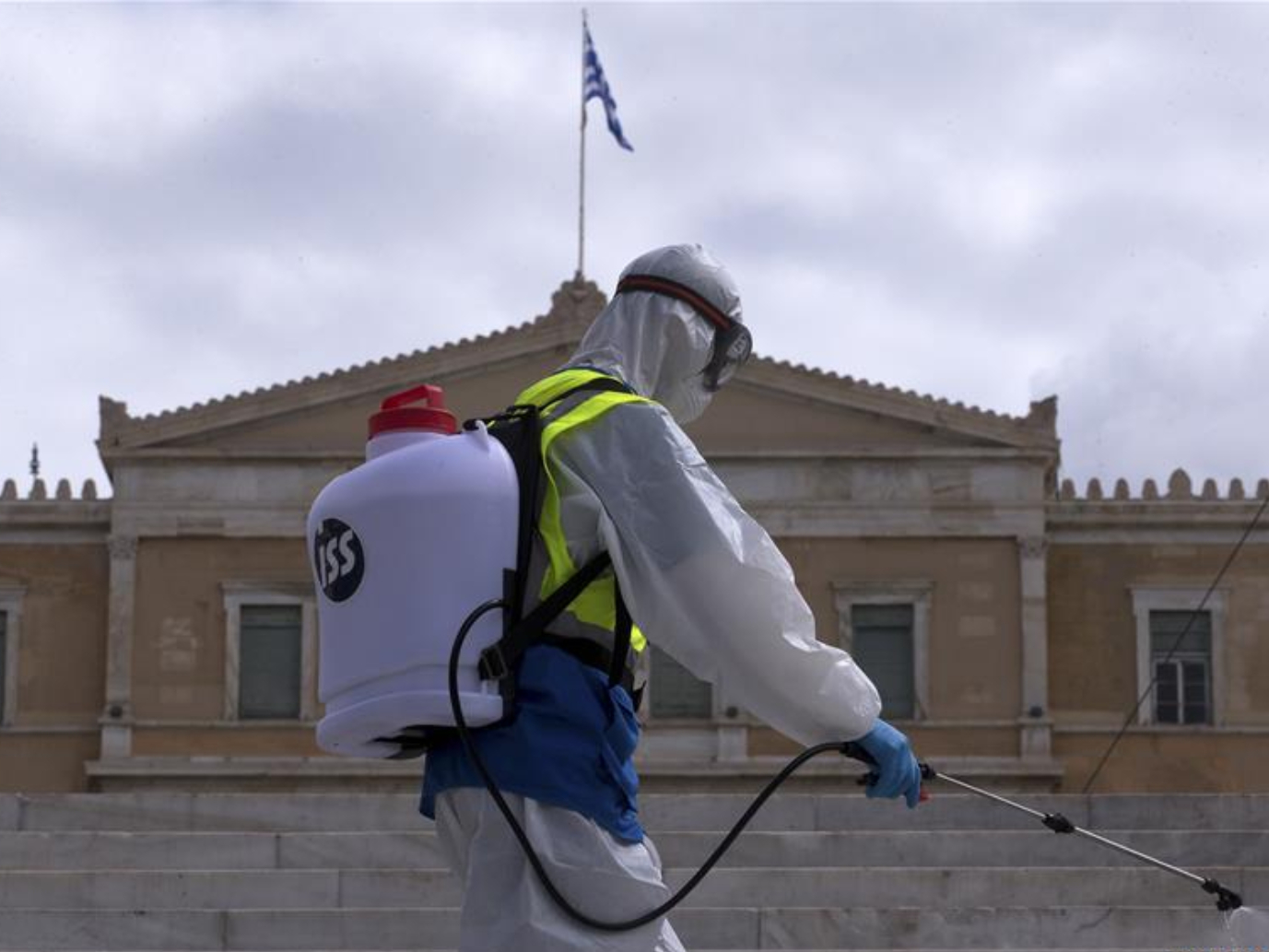 Employees spray disinfectant in Athens, Greece
