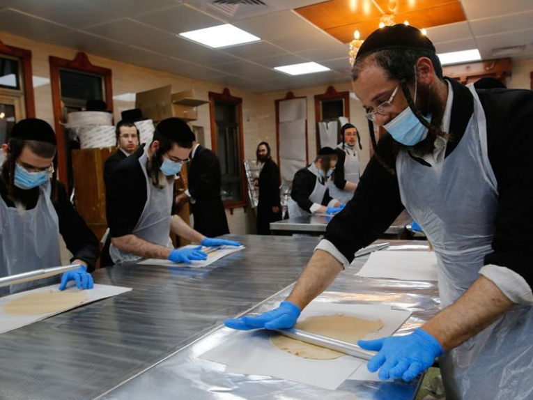 Ultra-Orthodox Jews prepare matza for upcoming Jewish holiday of Passover