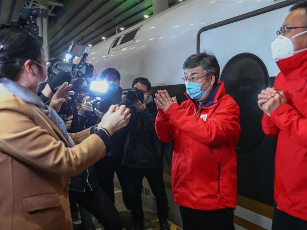 National medical team members arrive in Beijing after finishing tasks in Hubei