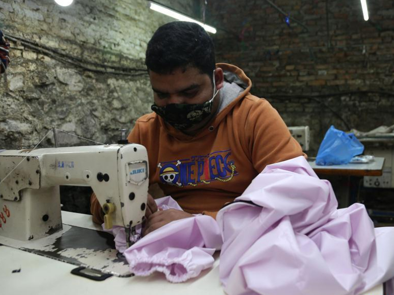 Factories begin to make protective suits in Kathmandu, Nepal
