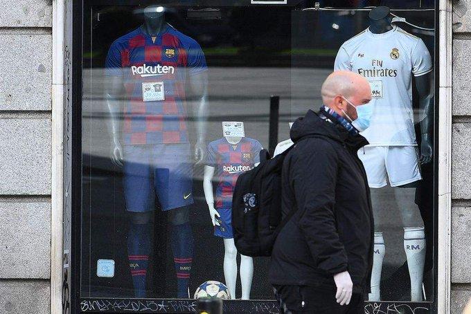 Barcelona to cut salaries in virus fight