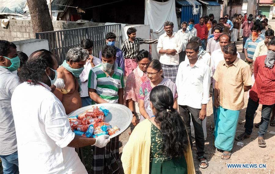People queue up for food on third day of lockdown in Kochi, India