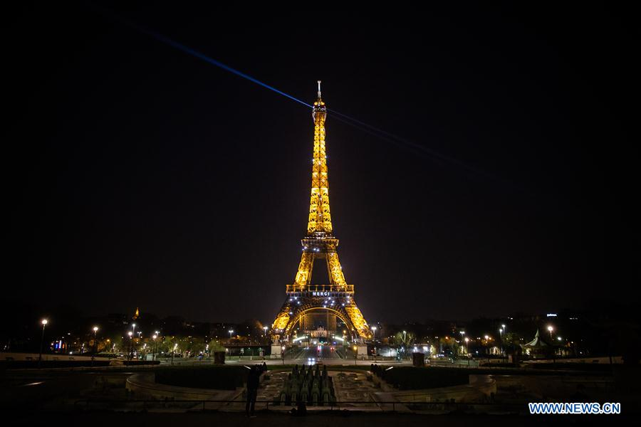 Words emblazoned on Eiffel Tower to encourage people to fight against COVID-19