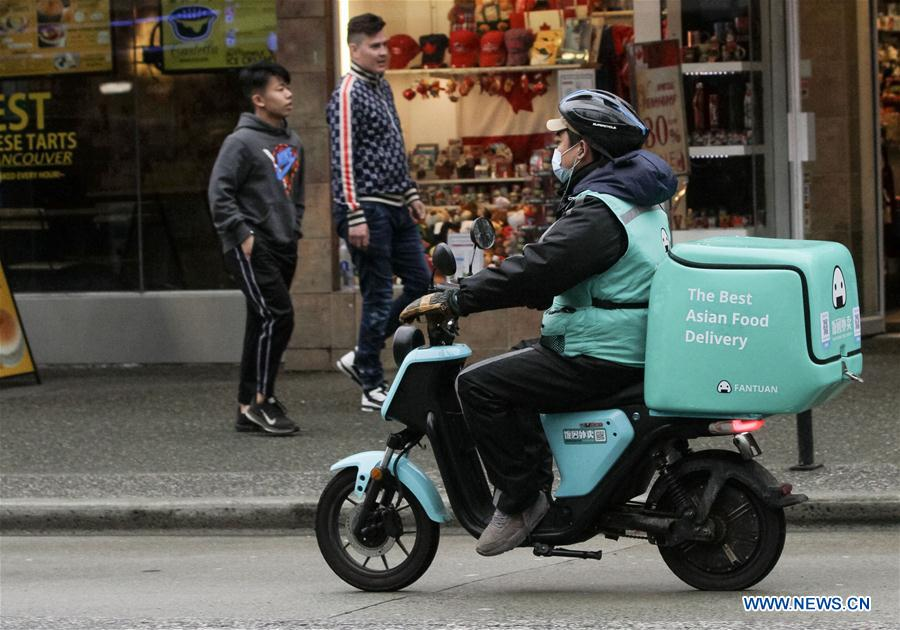 Food deliverymen rides in Vancouver, Canada