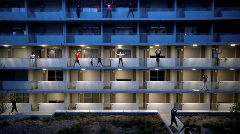 Beating lockdown inertia: French city-dwellers keep fit on balconies