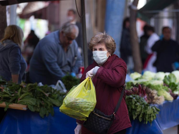 Greeks wearing face masks, gloves shop vegetables at open market in Exarchia, Athens