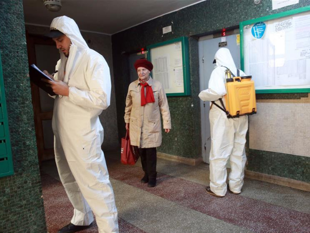 Staff disinfect at community in Bucharest, Romania