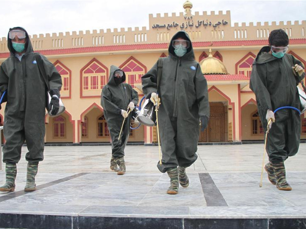 Workers disinfect mosque in Mehtarlam, Afghanistan