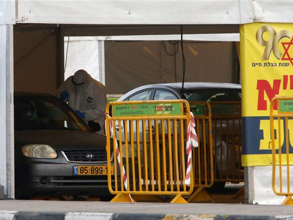 Medical personnel work at drive-through complex for COVID-19 testing in Jerusalem