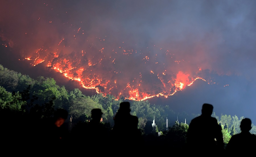 Firefighters continue to battle SW China forest fire