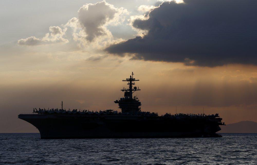 US warship captain seeks crew isolation as virus spreads