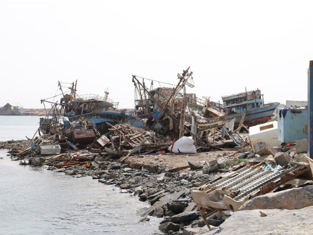 Destroyed boats seen on beach in Midi District of Hajjah, Yemen
